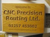 V carved wooden plaque
